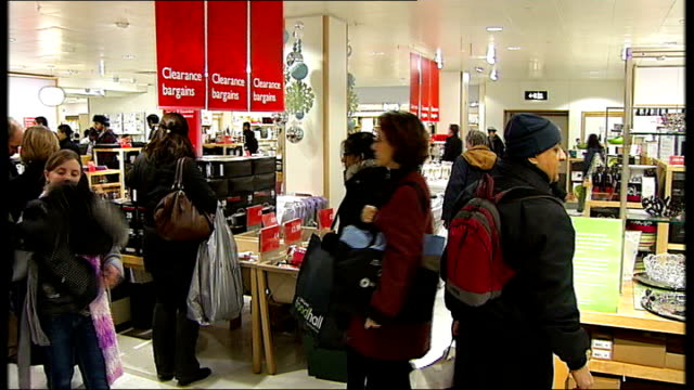 london john lewis int shoppers up escalator in john lewis store during christmas sales christmas decorations in foreground shoppers looking at sale... - vat stock videos & royalty-free footage