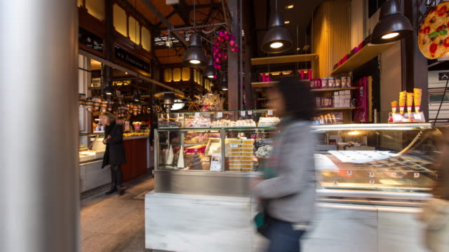 christmas shoppers at the mercado de san miguel, madrid - timelapse - tapas stock videos & royalty-free footage