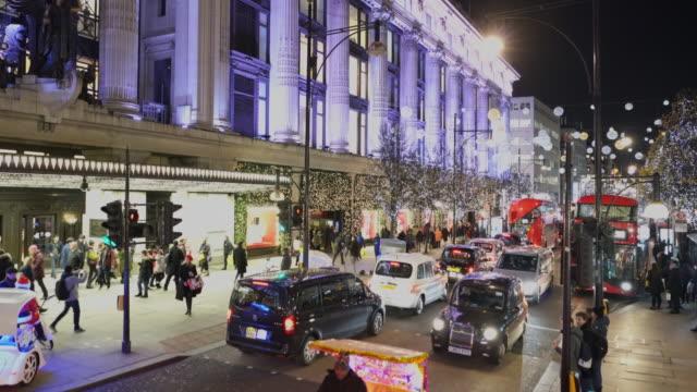 christmas shoppers on oxford street, london, uk. - shopaholic stock videos & royalty-free footage