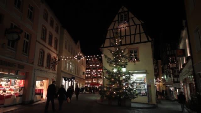 Christmas shoppers stroll through Old Town in Berkastel-Kues, Germany.