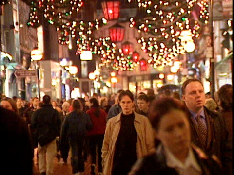 christmas shoppers walk along illuminated street dublin - editorial stock videos & royalty-free footage