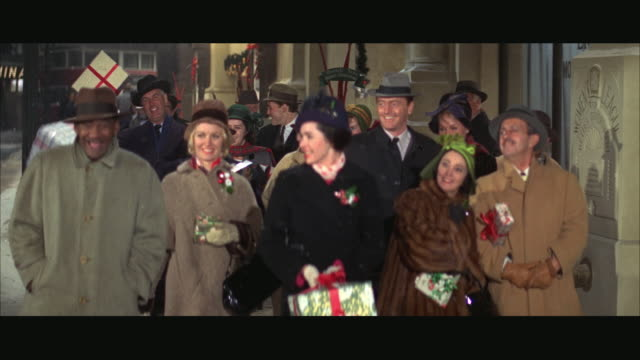 MS Christmas shoppers walking along sidewalk / Chicago, Illinois, USA