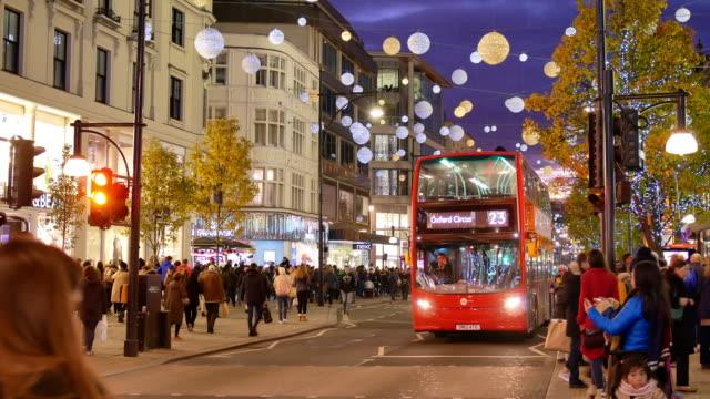 4k christmas & shopping on oxford street, london - oxford street london stock videos and b-roll footage