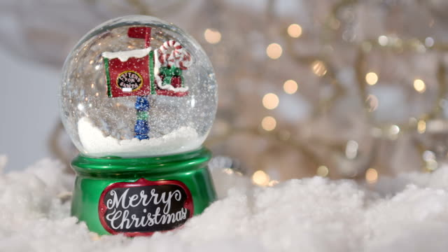 christmas snowball with christmas tree - christmas wrapping paper stock videos & royalty-free footage