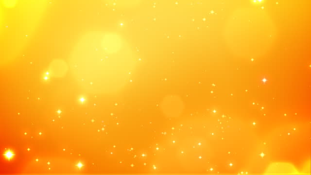 christmas sparkles orange background - loopable, hd - yellow background stock videos and b-roll footage