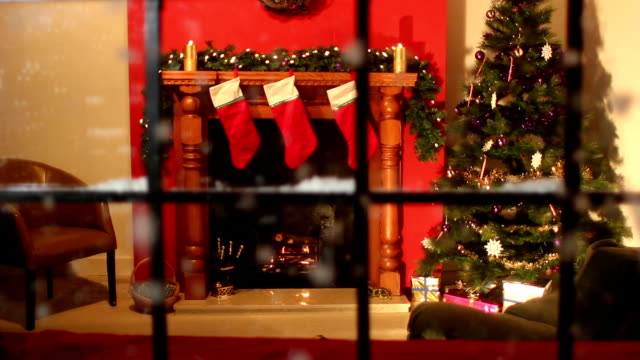 christmas stocking fireplace scene looking through window - snow falling - christmas stocking stock videos and b-roll footage