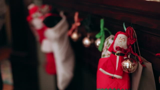 christmas stockings and decorations hanging from the fireplace. - stockings stock videos & royalty-free footage