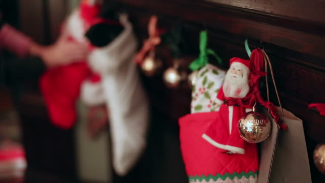 christmas stockings and decorations hanging from the fireplace. - christmas stocking stock videos and b-roll footage