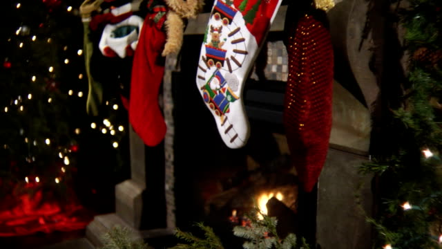christmas stockings with fireplace - stockings stock videos & royalty-free footage