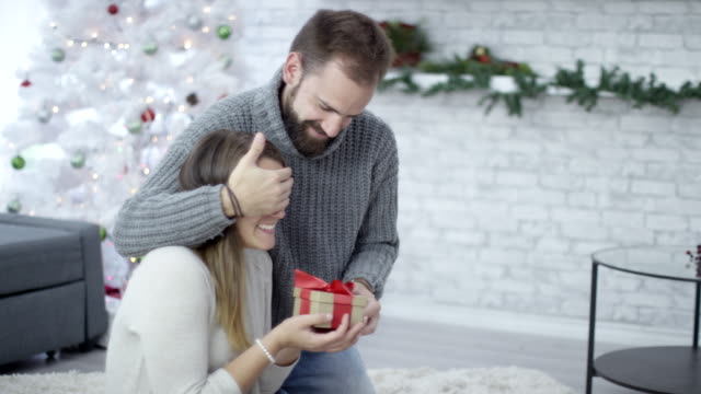Christmas surprise gift from a man to woman