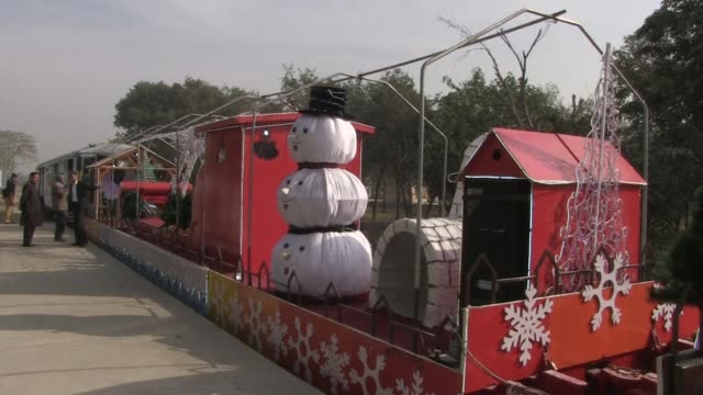 a christmas themed train sets out on a journey to crisscross pakistan in an effort to promote tolerance in the overwhelmingly muslim country - patient journey stock videos & royalty-free footage