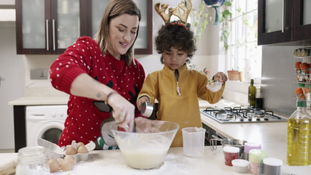 christmas time should be filled with plenty of treats - baking stock videos & royalty-free footage