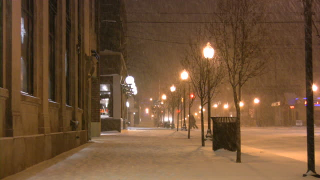 christmas time winter weather. snowstorm, snowflakes, snow, snowing. urban scene. - town stock videos & royalty-free footage