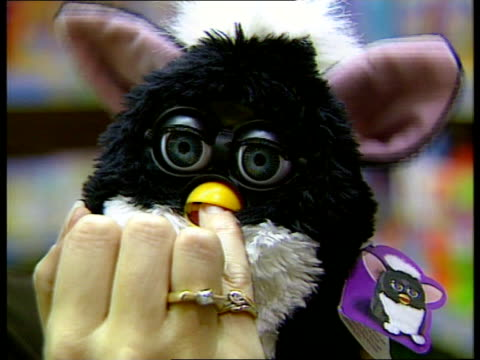 furby; england: london: int furby' toy being played with parents playing with furby furby making noises as played with vox pops - toy stock videos & royalty-free footage