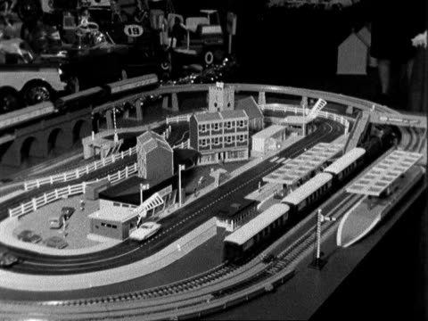 christmas toys preview; england: london: strand palace hotel 2 dolls on roundabout: railway and car layout; boy looks: new forth bridge; traffice :... - teddy boy stock videos & royalty-free footage