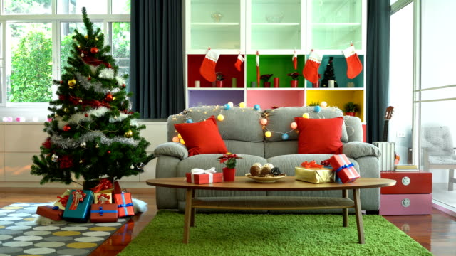 4k christmas tree and christmas decoration in a beautiful house with copy space - fiesta background stock videos & royalty-free footage