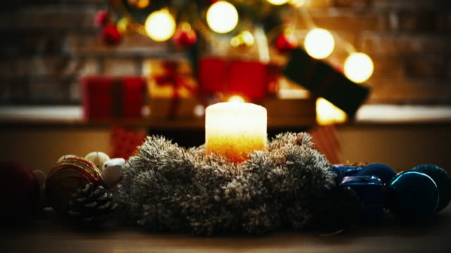 christmas tree and christmas decoration - warm and cozy atmosphere at home - christmas decore candle stock videos & royalty-free footage