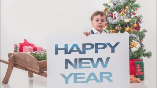 christmas tree and little boy holding new year blank - 2019 stock videos and b-roll footage