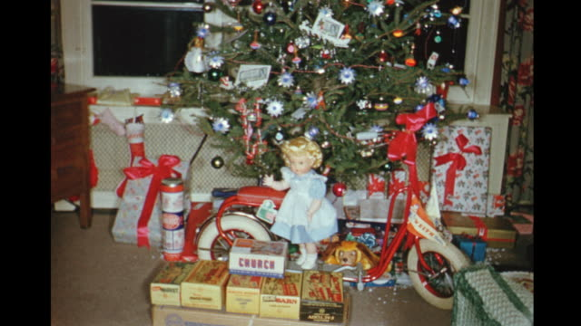 1954 home movie christmas tree and presents in living room / toronto, canada - christmas gift stock videos & royalty-free footage