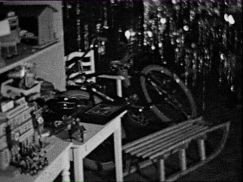 1932 b/w montage christmas tree and various toys / braunschweig, lower saxony, germany - christmas tree stock videos & royalty-free footage