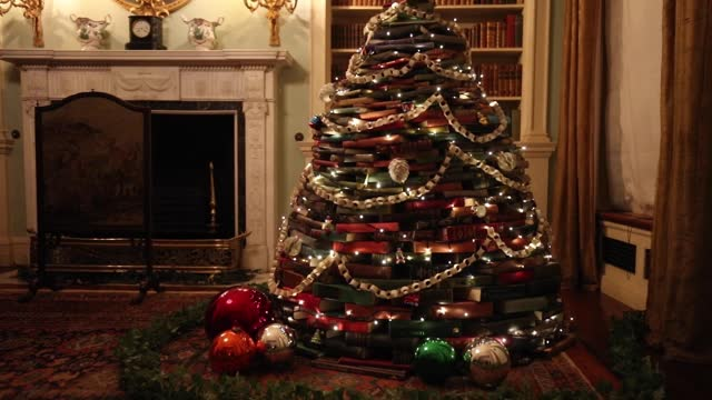 christmas tree, crafted entirely from books, in the library at the national trust's polesden lacey, an edwardian house and estate at great bookham,... - national trust video stock e b–roll