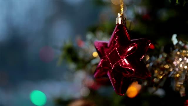 Christmas Tree Decorations Illuminated and Winter Snowstorm