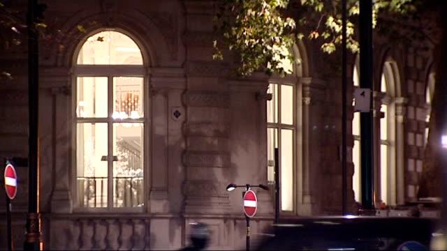 christmas tree erected in trafalgar square england london embankment general view of illuminated london eye with embankment traffic in foreground/... - erezione video stock e b–roll