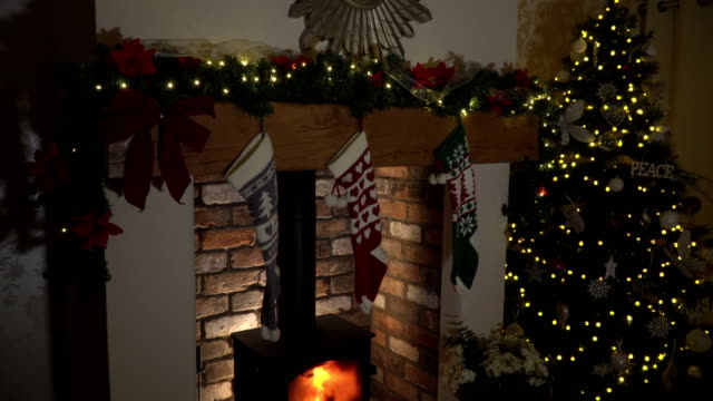 4k dolly: christmas tree, fireplace and mantelpiece - christmas stocking stock videos and b-roll footage