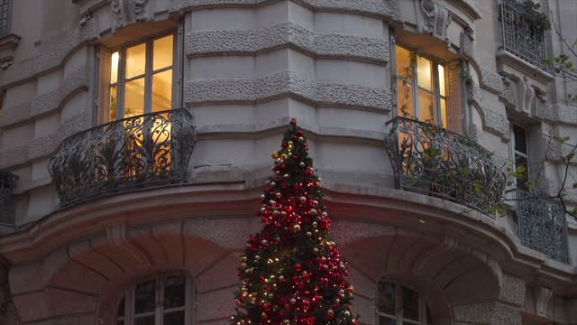 christmas tree in front of a building facade - fairy lights stock videos & royalty-free footage