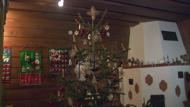 ms td tu christmas tree in living room / near salzburg, austria - austria stock videos and b-roll footage