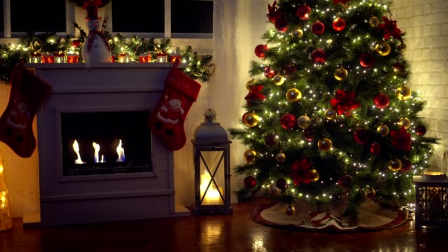 christmas tree near fireplace at home - wreath stock videos & royalty-free footage