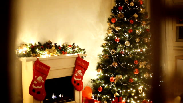 christmas tree near fireplace - christmas stocking stock videos and b-roll footage