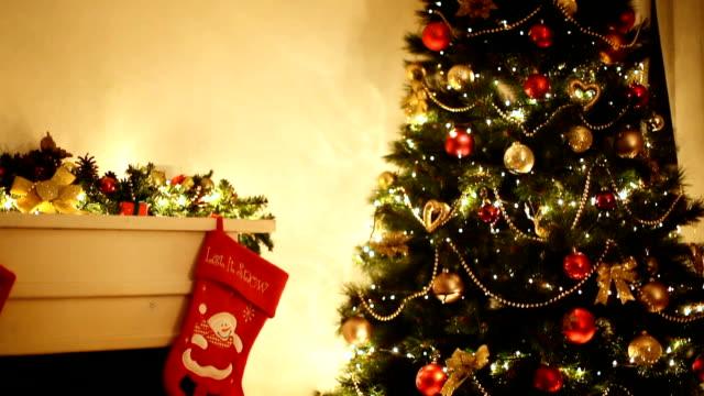 christmas tree near fireplace - christmas stocking stock videos and b-roll footage
