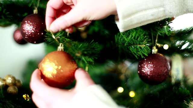 hd: christmas tree ornaments - decorating the christmas tree stock videos & royalty-free footage