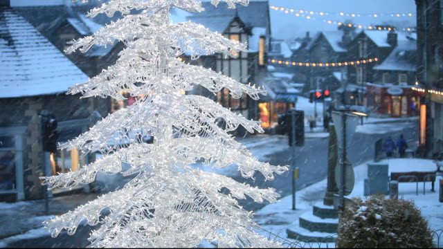 a christmas tree over the main street in ambleside town centre, lake district, uk - snowing stock videos & royalty-free footage