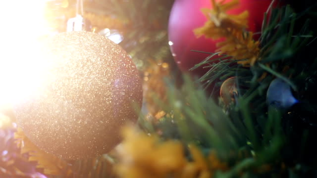 pan christmas tree with ornaments and defocused lights - christmas tree stock videos & royalty-free footage
