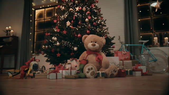 christmas tree with presents in front of it - christmas tree stock videos & royalty-free footage