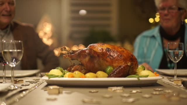 christmas turkey on dining table - thanksgiving plate stock videos & royalty-free footage