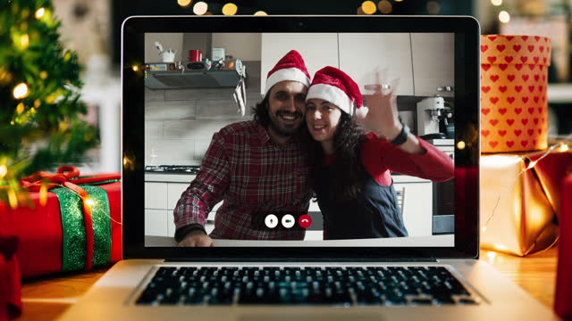 christmas video call on a laptop screen at home - christmas stock videos & royalty-free footage