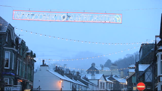 A Christmas welcome sign in the snow, Ambleside, Lake District, UK.