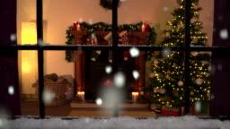 4K Christmas window scene. Snowing outside. Warm fire inside