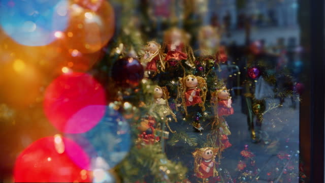 christmas window with reflection of people holidays christmas lights - ornate stock videos and b-roll footage