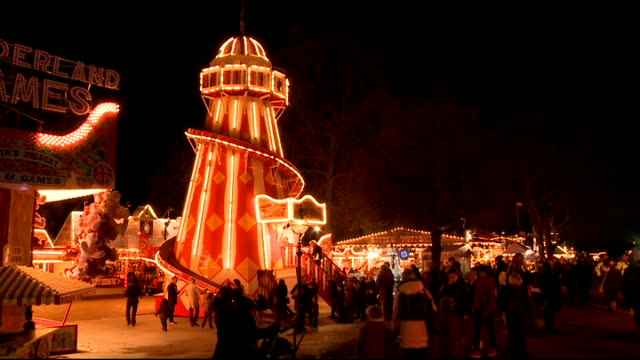 christmas 'winter wonderland' to open in hyde park england london hyde park ext various shots of winter wonderland / merry christmas chocolate hearts... - ロンドン ハイドパーク点の映像素材/bロール