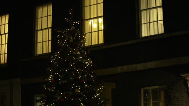 a christmas wreath and tree outside 10 downing street - downing street stock videos & royalty-free footage
