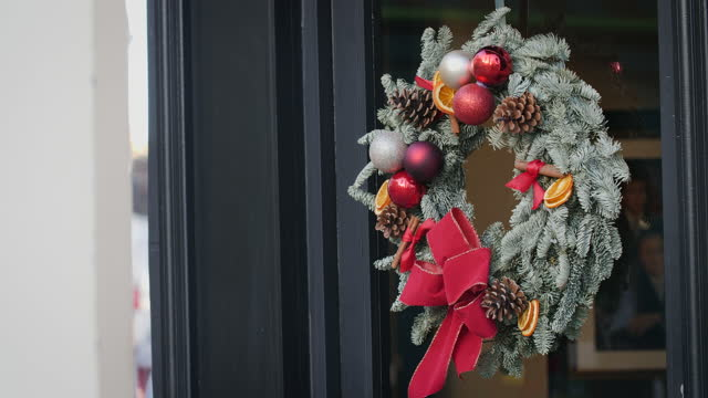 christmas wreath hangs on door - wreath stock videos & royalty-free footage