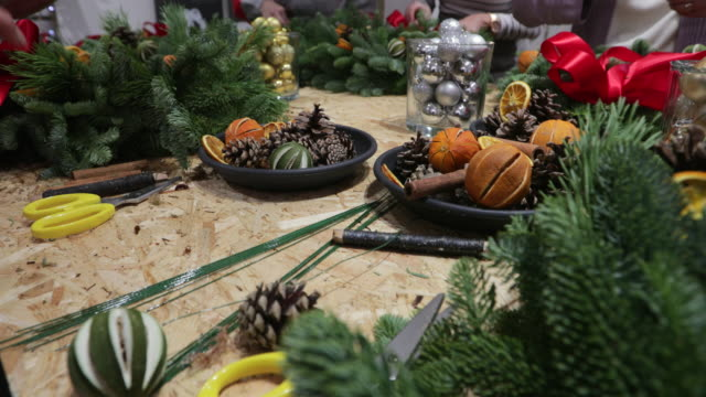 christmas wreath making workshop - wreath stock videos & royalty-free footage