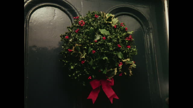 cu christmas wreath on a door, 1970s - wreath stock videos & royalty-free footage