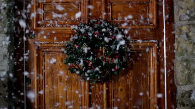 Christmas Wreath on door, Snowing