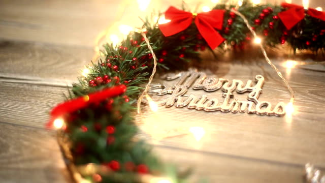 christmas wreath with decorations on the shabby wooden background - wreath stock videos & royalty-free footage