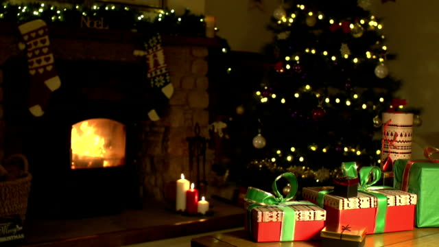 christmasliving room scene with gifts, tree & fireplace - christmas stocking stock videos and b-roll footage